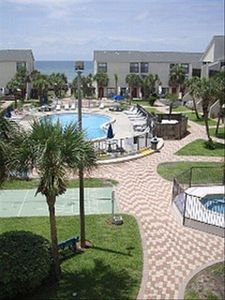 Largo Mar's heated pool, hot tub, shuffle board & tropical landscaping!