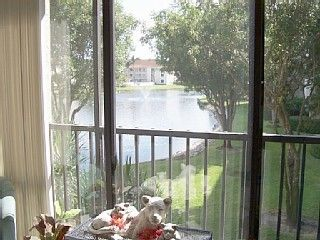 View from living room overlooking lake & fountain.