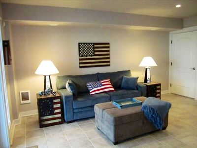 USA themed room with pull out couch (queen) and pull out ottoman (twin)