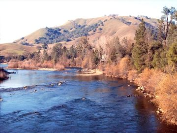 Coloma house rental - river view from bridge- private access to river from property on right