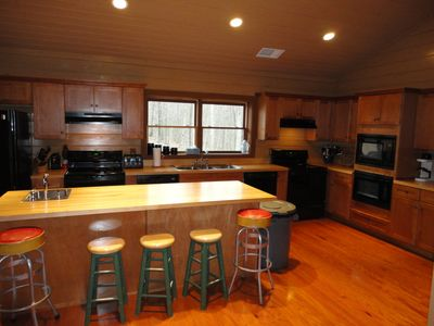 The Deer Cabin kitchen with two of each appliance. The washer/dryer is nearby.