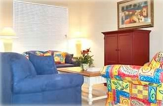 The living room features a cable TV w/DVD and Free High Speed Internet Access