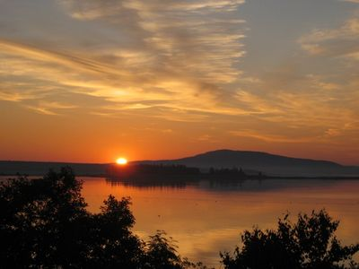 View from the deck of the sun rising over Mount Desert Island