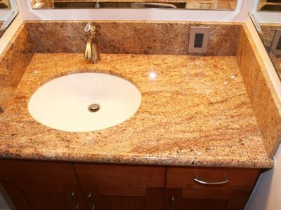 Beautiful granite vanity and walls grace the newly remodeled bath.