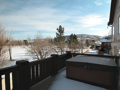 Park and mountain view deck with private hot tub and gas grill