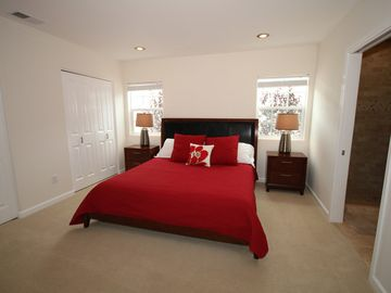 Large luxury master bedroom with 2 closets, TV, king bed and private bath.