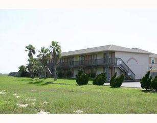 Front of 18 unit condo complex. When you step outside you can hear the waves! - Corpus Christi condo vacation rental photo
