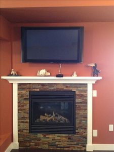 Gas fireplace in living room area.