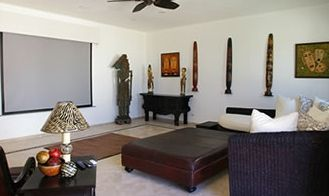 Media room with 120 inch screen, and amazing Balinese and Fijian art