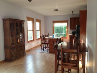 Utica house photo - Dining room / kitchen / bar setup has room for the whole group to eat together
