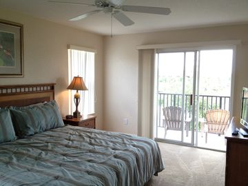 Master Bedroom with Balcony and private Bath and Flat Screen TV.