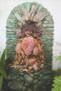 Custom Brazilian Crystal fountain in large covered patio recycles the water.