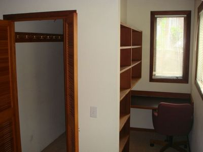walk in closet and small desk in Master Bedroom