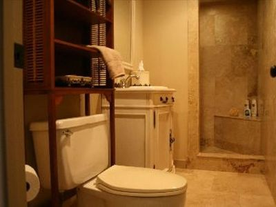 comfortably accommodate this marble stone oversize shower with a seat.