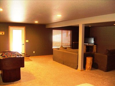 Lower level family room with flat screen tv and foosball table