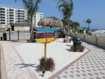 TikiCabana for kids next to pool-overlooking Gulf-hear the waves to your right?