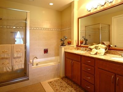 Elegant Ensuite Master Bathroom With Large Soaking Romantic Tub !