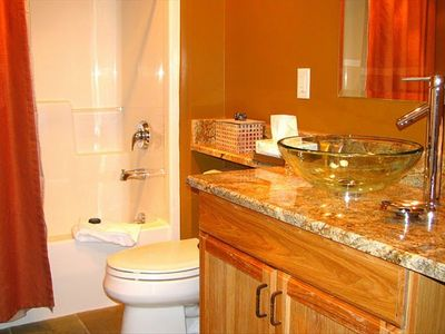 3 FULL BATHS WITH TUB/SHOWERS, GRANITE COUNTERS & SLATE FLOORS.