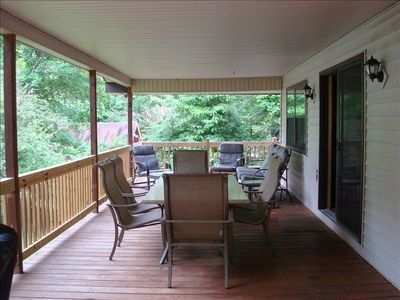 Outdoor Deck area with seating, table for 6 and gas grill.