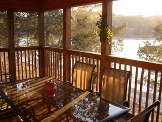 Branson cabin photo - Relax in serene comfort in the screened-in porch right on the water's edge.