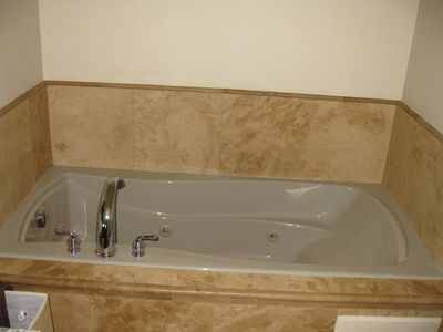 Jacuzzi tub in master bathroom for some R & R
