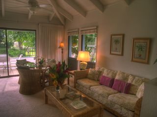 Poipu condo photo - The living room opens to the lanai with a lovely ocean view.