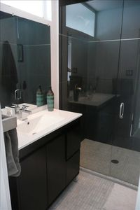 Master Bath, carerra marble floors, large walk in shower w/ charcoal color tile.