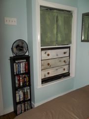 Cute built in, drawers below, closet rod above and more movies - Buttermilk Bay cottage vacation rental photo