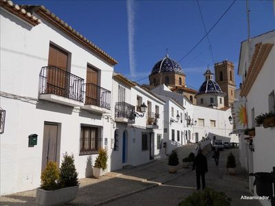 The blue roof of the church is typical for Altea old town