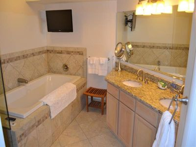Jacuzzi tub and spacious counter tops in master bath.