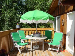 Cariboo cottage photo - Cabin 1 - Enjoy an outside dinner on the deck