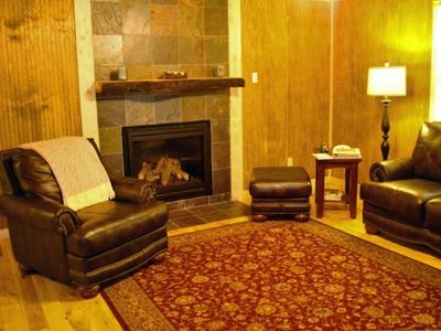 Living room with Gas Fireplace and new leather furniture with cabin decor