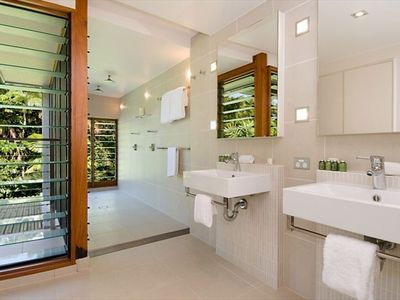 Elegant Fully Tiled Ensuite Bathroooms to all Master Suites, with Garden Views