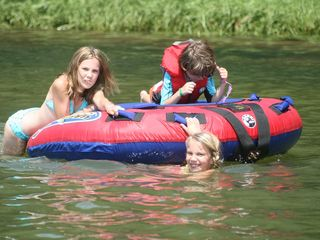 Stanley Bridge cottage photo - Fun filled days on the river. Swimming, cannon balls and basking in the sun.