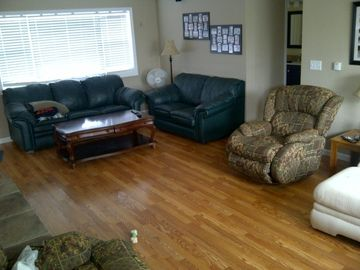 large family room, sofa with pull out bed that sleeps two.