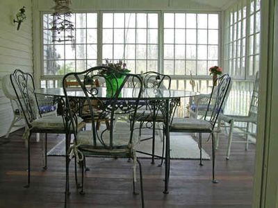 Enclosed back porch great for meals