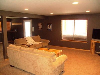 Lower level family room -flat screen tv, foosball table. Hot tub right outside