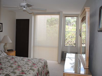 This is the master bedroom with attached bathroom, ceiling fan, a/c and closet.