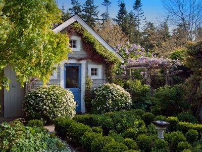 Herb garden and wisteria arbor create a charming setting in the courtyard.