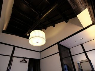 Traditional beams line the ceilings of the bedroom. - Kyoto townhome vacation rental photo
