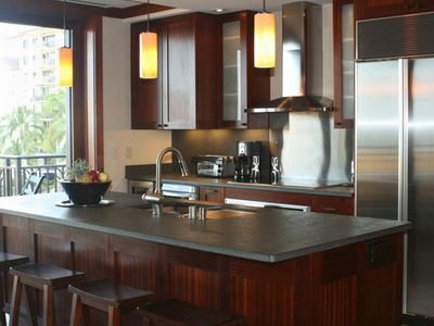 Gourmet kitchen with Wolfe and SubZero stainless steel appliances.
