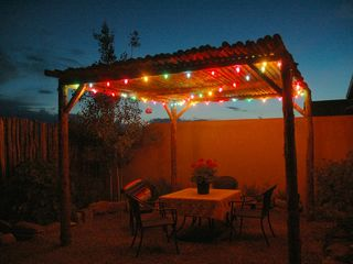 Evening dining under the stars - Taos house vacation rental photo