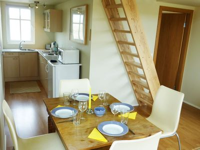 Bjalli: Dining & kitchen, stairs to sleeping loft
