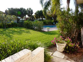 Boca Raton house photo - Side yard with pool beyond