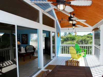 Comfortable seating on the screened upstairs porch