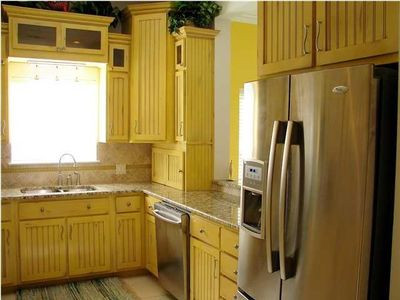 Kitchen with custom cabinets, granite counters and state-of-the-art appliances.