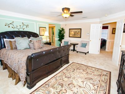 "Lavishly appointed master bedroom with 46"" Wall mounted TV. Master bedroom bath"