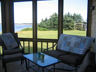 Augustine Cove cottage photo - Enjoy view from the serenity of the screen porch.