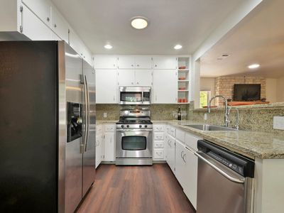 Fully equipped stylish kitchen with stainless appliances and granite countertops
