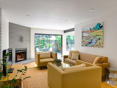 La Jolla townhome rental - Cozy sunken living room with gas fireplace, HDTV and fenced patio